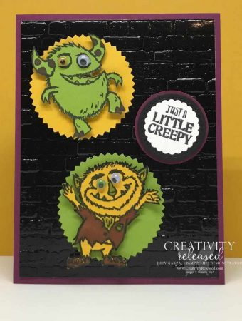 Two cute monsters on a Halloween card front