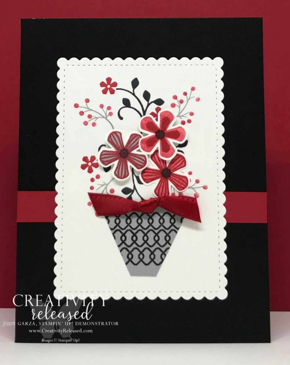 A black card base with a scallop white rectangle displaying a gray basket of red, gray and black flowers stamped with images from the Sale-a-Bration stamp set Thoughtful Blooms