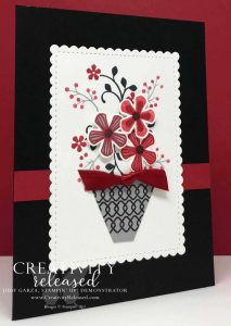 Red, Black, and white card front with focal image of a basket of flowers