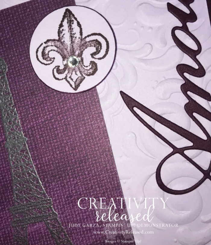 An up close picture of the stamped Fleur De Lis and the die-cut AMORE. Use this card to show and share love