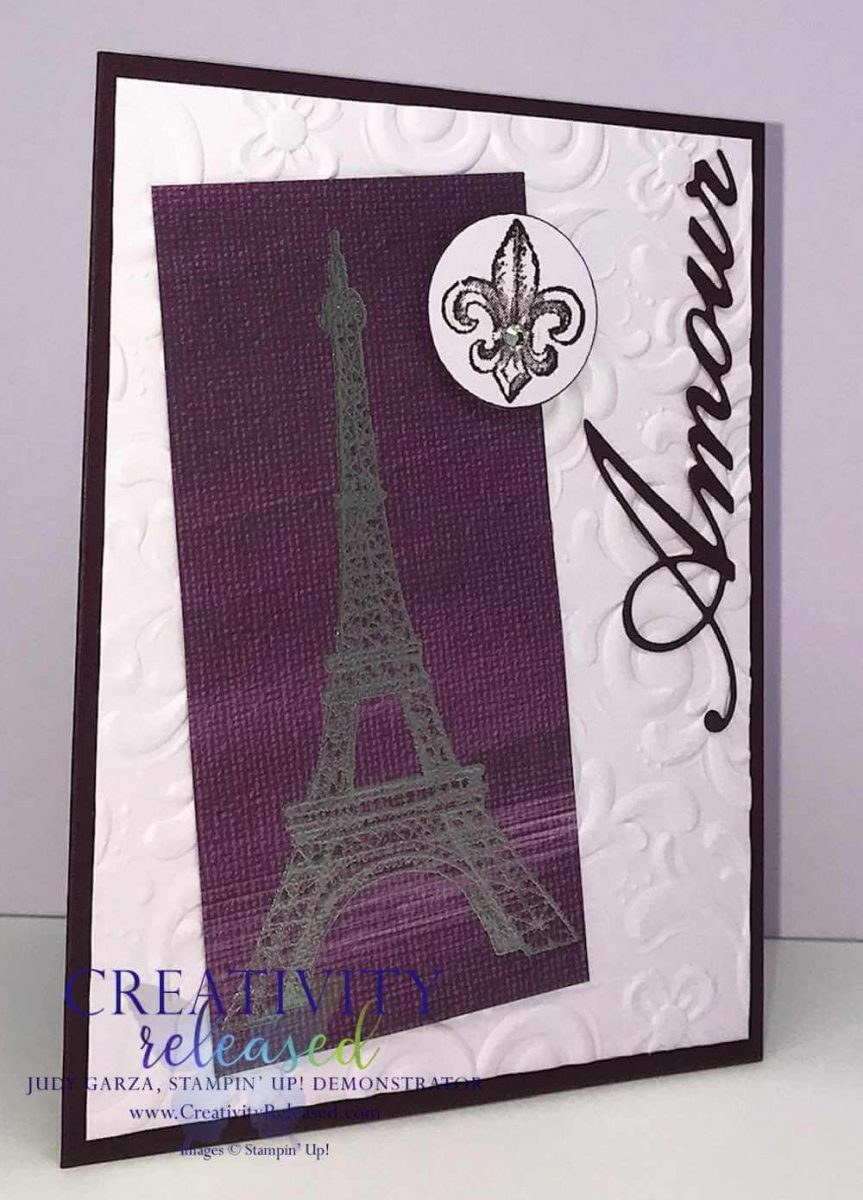 A photo showing a card that when sending will be Showing and Sharing Love. Has an Eiffel Tower and the work AMORE on it