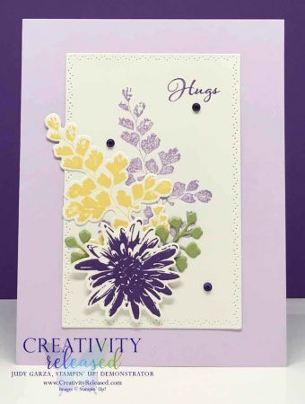 A card sending Hugs using the Positive Thoughts stamp set with coordinating dies in Purple and yellow hues.