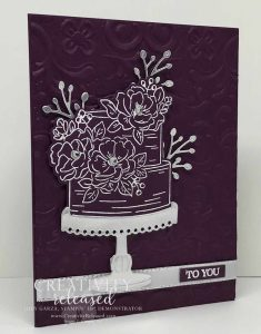 White embossed birthday cake on Blackberry Bliss Cardstock.