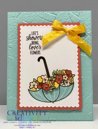 An encouragement card using the Under My Umbrella stamp set. The umbrella is up-side-down and filled with flowers