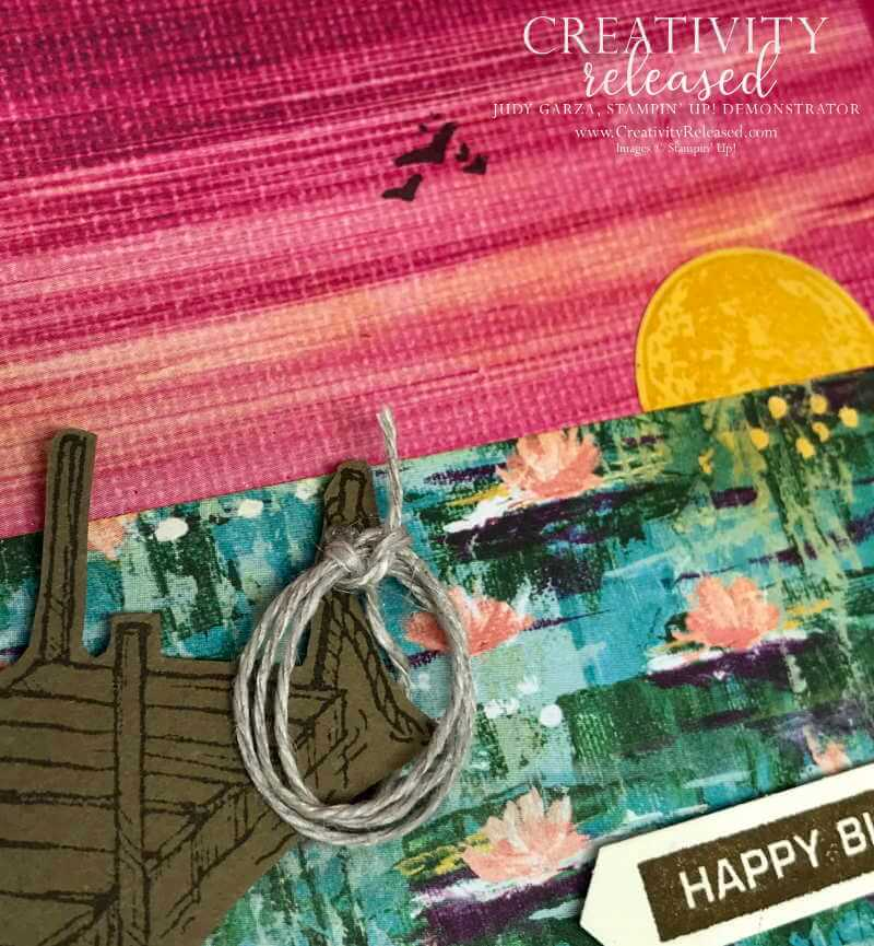 An up close look at a Birthday card displaying a lakeside sunset using Stampin' Up! Sale-a-bration Designer Series Paper