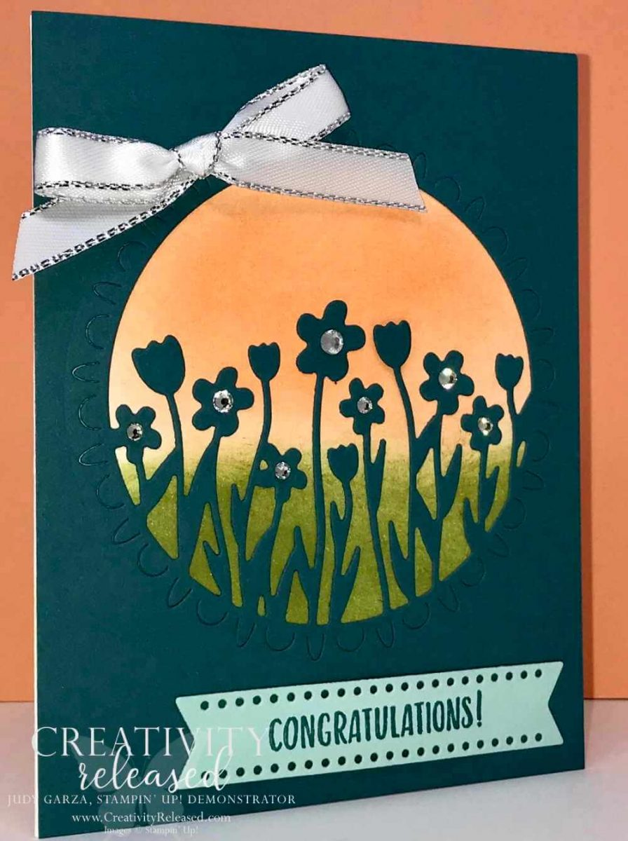 A congratulations card showing flowers against a sunset using the Stampin' Up! Sending Flowers dies