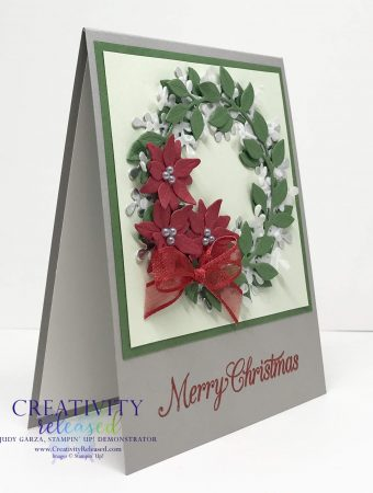 Side view of Stampin' Up!'s Arange A Wreath Bundle meets Poinsettia dies for a lovely Christmas Card.