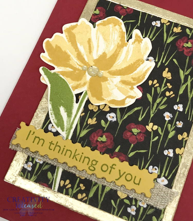 an up close look at a Thinking of You greeting card with a Real Red base with flowers in a gilded frame. Images by Stampin' Up!