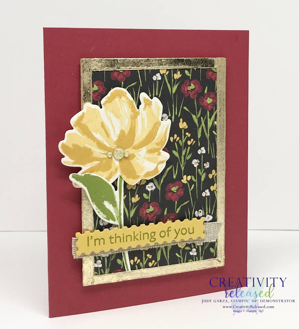 A side view of a Thinking of You greeting card with a Real Red base with flowers in a gilded frame. Images by Stampin' Up!