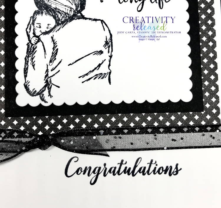 An upclose look at a black and white Stampin' Up! greeting card congratulating a new grandparent.