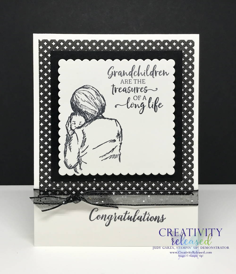 A black and white Stampin' Up! reeting card congratulating a new grandparent.