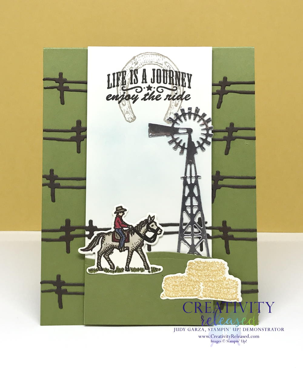 "A Texas-style card with fencing across an Old Olive card base. The white center panel displays a cowboy on a horse, bales of hay and a windmill, all from the Stampin' Up! stamp set ""Ride The Range"""