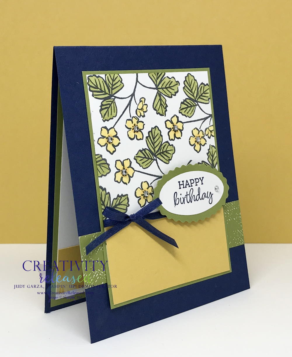 A side view of a birthday card showing the product coordination of Stampin' Up! Products on a birthday card in Night of Navy, Bumble Bee and Old Olive.