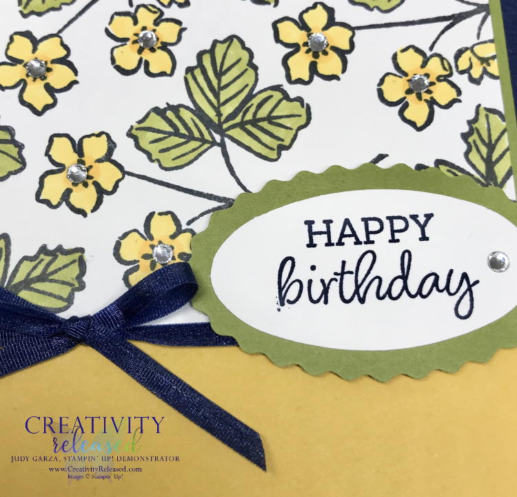 A close up view of a birthday card showing the product coordination of Stampin' Up! Products on a birthday card in Night of Navy, Bumble Bee and Old Olive.