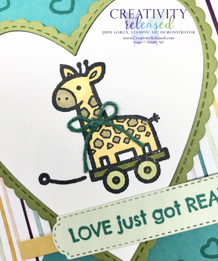 An up close look at a new baby card with a Pull Toy image by Stampin' Up! on the front.