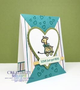 The side view of a new baby card with a Pull Toy image by Stampin' Up! on the front.
