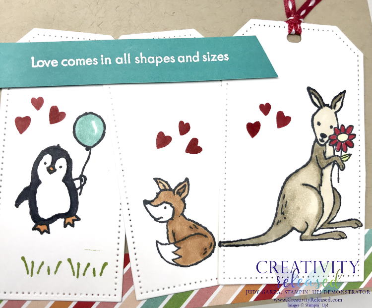"""A close up view of an """"in this together"""" type card using three tags with a penguin holding a balloon on the first, a red fox on the second and, finally, a kangaroo holding a flower. All stamps and supplies are products of Stampin' Up!"""