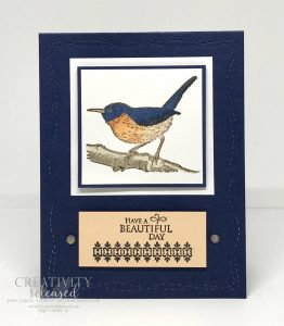 """A greeting card in navy and peach that depicts a bird on a branch. The sentiment reads """"Have A Beautiful Day."""" All stamps, ink, supplies and tools used are by Stampin' Up!"""