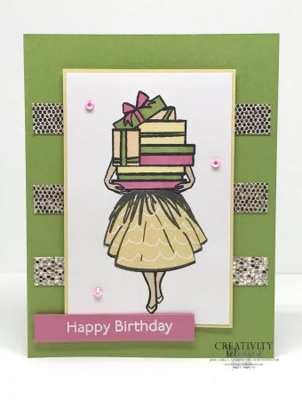 A birthday card using CCMC681 sketch challenge. A lady holding a mound of gifts that are so high they cover her face. Stamp set Delivering Cheer by Stampin' Up!®