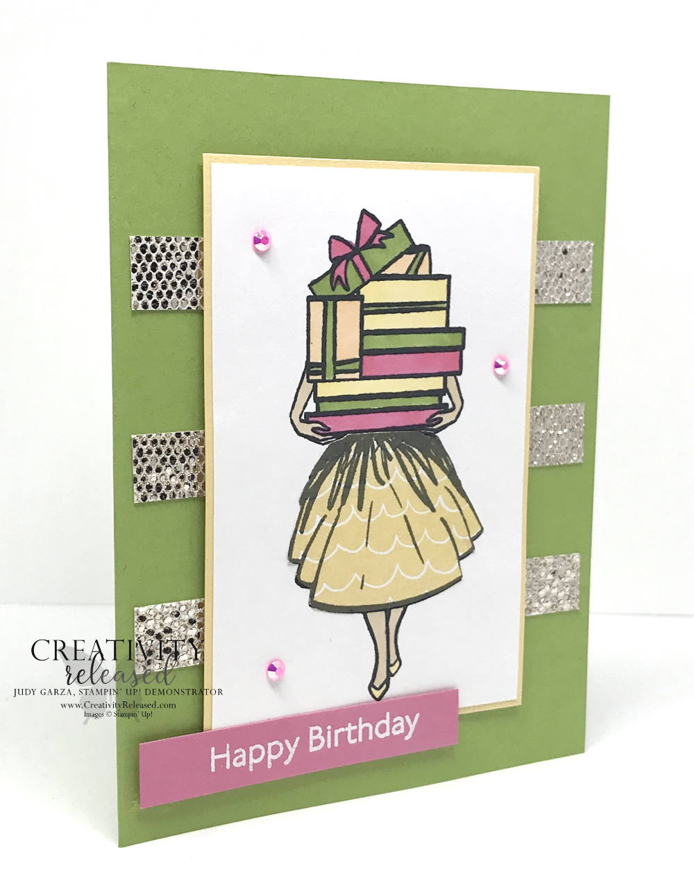 A side view of a birthday card using CCMC681 sketch challenge. A lady holding a mound of gifts that are so high they cover her face. Stamp set Delivering Cheer by Stampin' Up!®