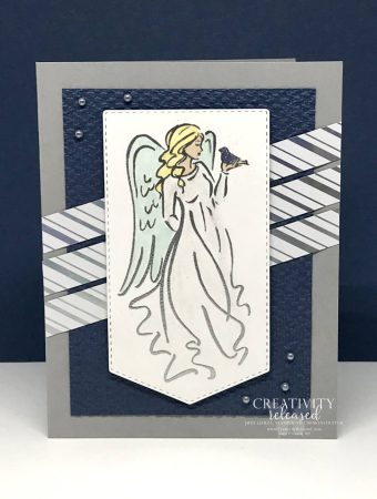 AChristmas card with an angel in a flowing robe stamped on a banner and , accented by strips of shiny, silver-striped DSP. All images are from Stampin' Up!